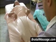 Asian girl is getting a good massage underneath a blanket
