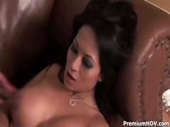 Hot busty brunette slurps on his cock and then gets pounded
