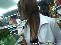 Japanese girl getting naked and naughty in store