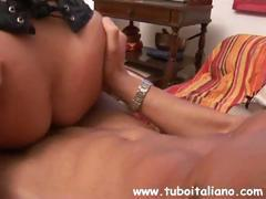 Veronica is a blonde with huge gazongas who gets screwed by her Italian lover