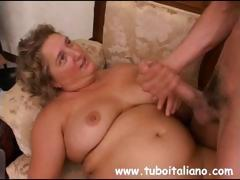Amateur blonde Itaian BBW is riding on his cock and gets cumshot
