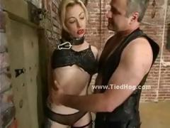 Fat man in leather takes his sex slave tied in chains and torments her in bdsm brutality
