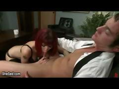 Redhead tranny gives guy blowjob in office on leather sofa