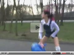 Girl is using a gym ball.