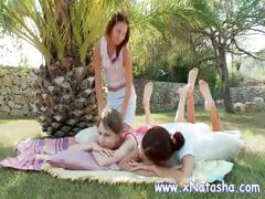 Lesbian teens in the back yard get naked and have fun licking