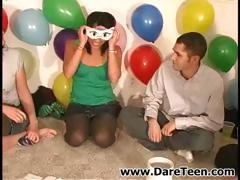 Naughty young teens playing dice and the losing chicks kiss