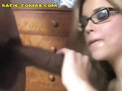 Katie is a blonde slutty chick wearing glasses who gets a black dick to cum on her belly
