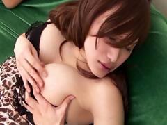 Two hottie Japanese cuties masturbate on a sofa side by side
