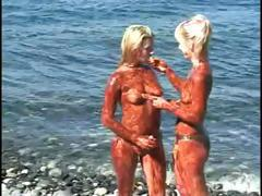 Taffy and Candy do some artistic and sexy body painting and then wash up in the sea