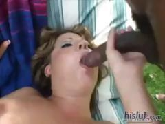 On a bench in the garden, two black guys and their massive dicks fuck a young blonde chick