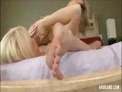 Two sexy blonde lesbians play with tits and feet and eat pussy