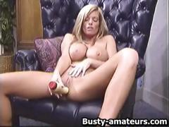 Tera is a blonde big-breasted chick who masturbates on a chair with her big dildo