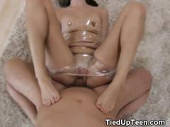 Brunette Teen Wrapped In Plastic Giving Foot Job