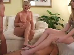 Two naughty slave cocks are dominated by the sexy feet of their mistresses