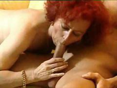 Mature German lady with fiery red hair eats young dick and gets nailed