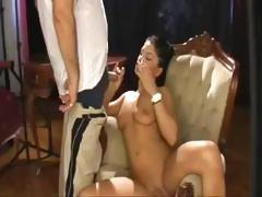 Brunette cutie Crystal refuses to put out her smoke just to suck his cock so she puffs both