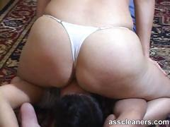 Mistress in bikini smothers slave by sitting on his face