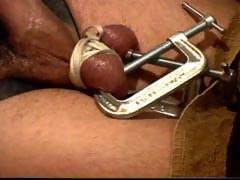 Leather strait jacketed stud gets balls crushed with a metal wood clamp as I jack of to his screams