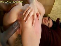 Brunette MILF with a nice ass eats black cock and then gets drilled