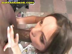 Brunette slut goes down on a bunch of black cocks for a facial