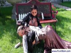 Lesbians in the backyard with the mistress putting cream on slave