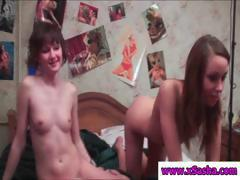Two skinny girls get naked and play around in their bedroom