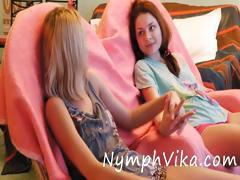 Russian lesbian teens sit side by side and toy their pussies