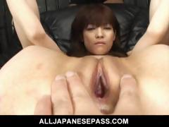 Megumi Morita Asian doll pokes her pussy with a fake cock