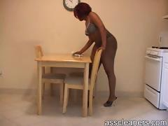 Fat ebony behind is shown as mistress cleans her table