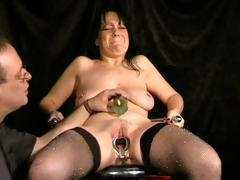 Chubby brunette gets tortured with pussy clamps and needles