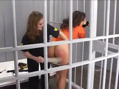 Prison guard gives this inmate a spanking an bites her nipple