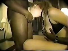 Slave is made to take on two black cocks and sucks them off